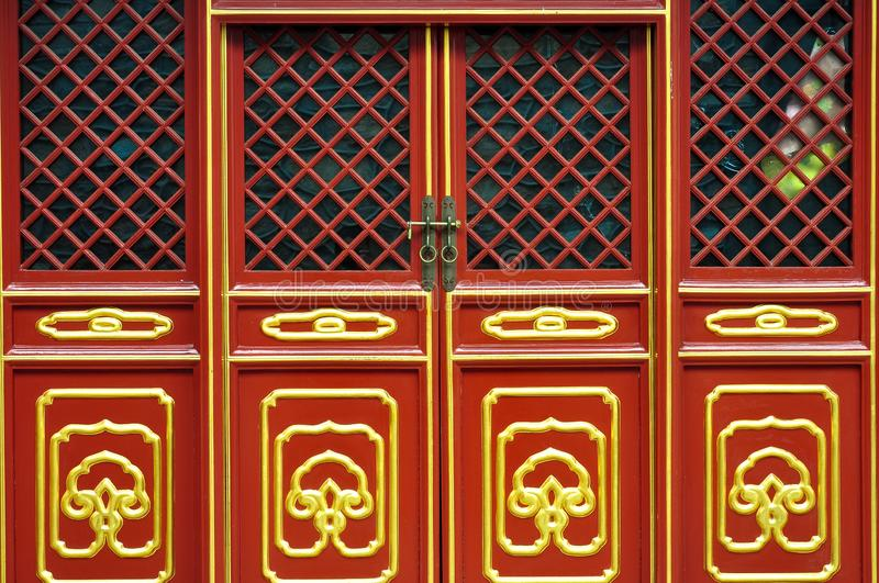 Wooden Door and window colorful pattern of Chinese traditional architecture, in red stock images