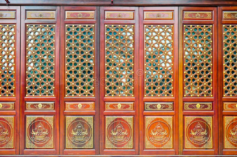 Wooden door and window colorful pattern of Chinese traditional architecture, in red stock image