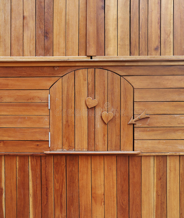 Wooden door in wooden cabinet stock photography