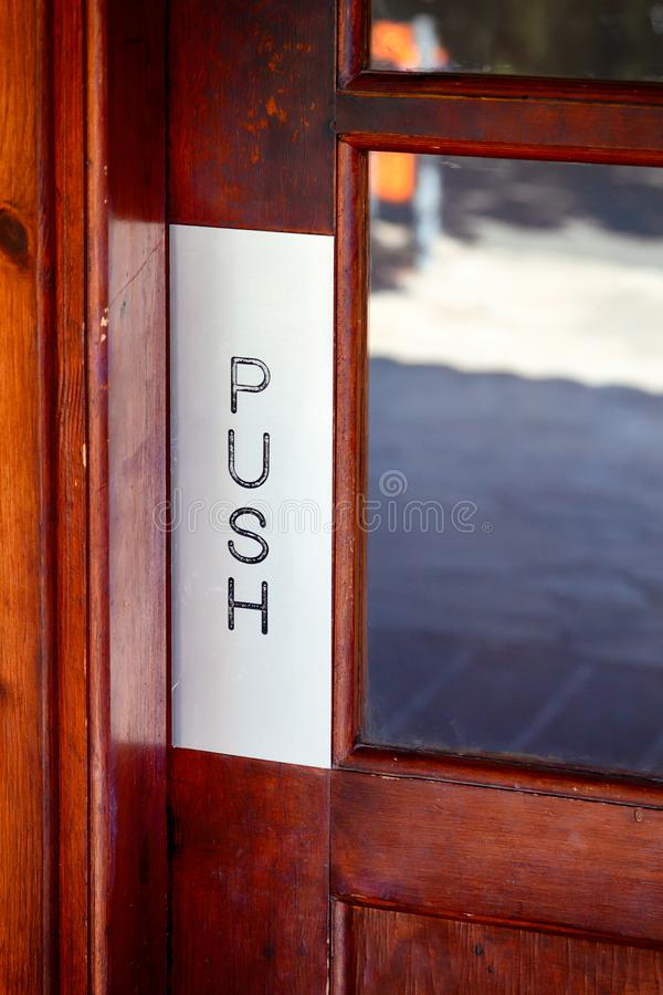 Wooden door with world Push. stock images