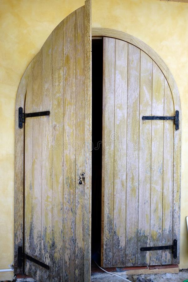 Download Wooden Doors In Arched Doorframe Stock Photo   Image Of Stucco,  Faded: 74338984