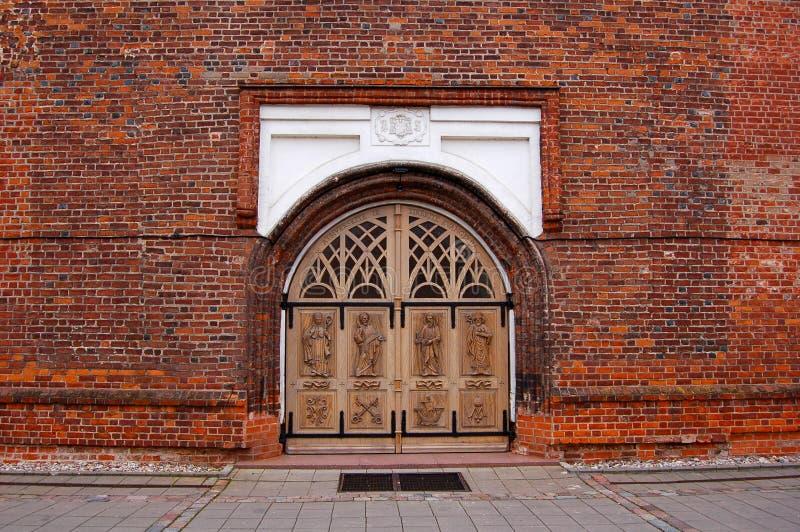 Wooden doors in brick wall royalty free stock photos