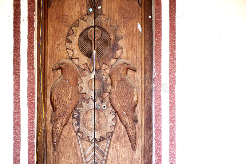 Wooden doors with carved bird design royalty free stock photography