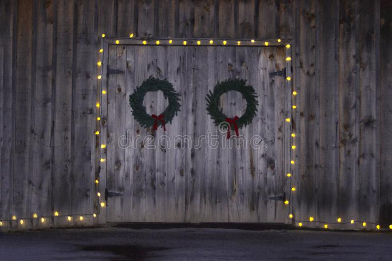 Wooden doors decorated with Christmas lights stock images