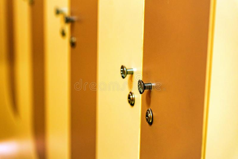 Wooden doors in sports gym locker room royalty free stock photography