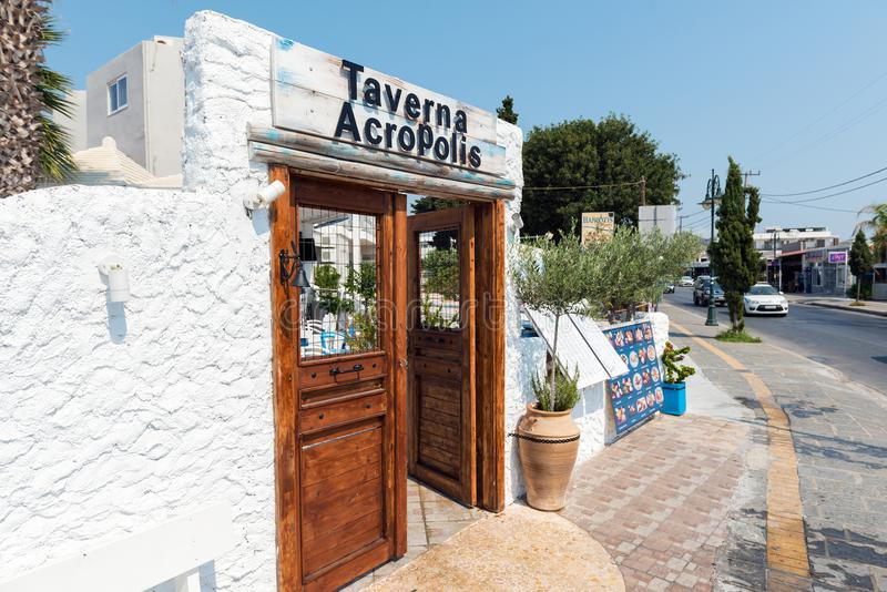 Wooden doors in white arch as tavern entrance decoration. Rhodes island, Greece. stock photos