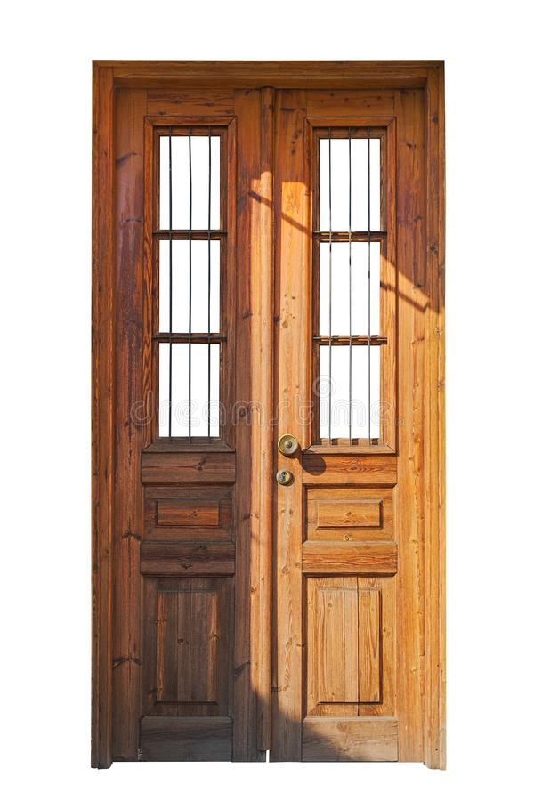Wooden double door with bars stock images
