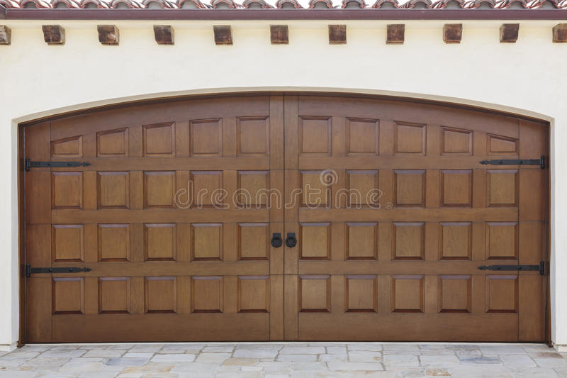 Wood Double Garage Door. Download Wooden Double Swinging Garage Doors Of  Home Stock Photo