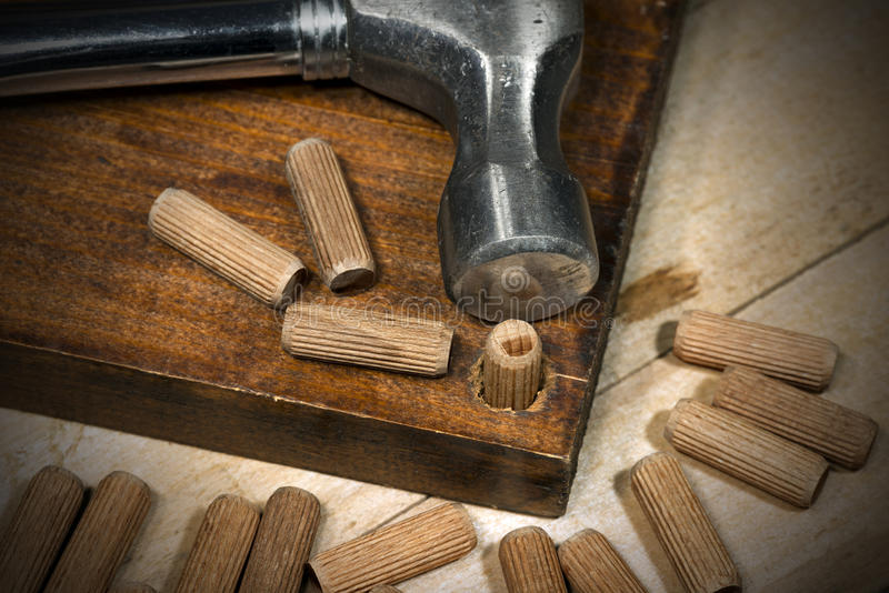Wooden Dowels on a Brown Plank stock photo