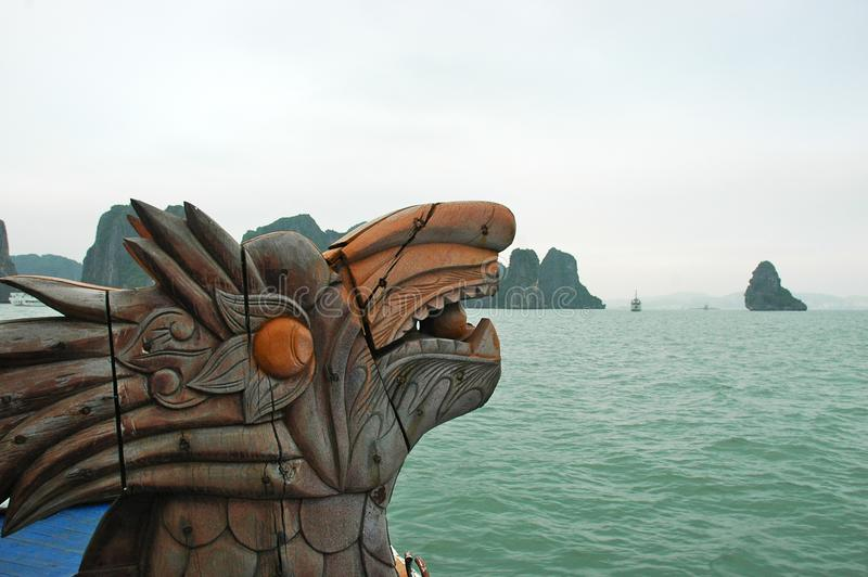 A wooden dragon figurehead on a prow of a boat. royalty free stock image
