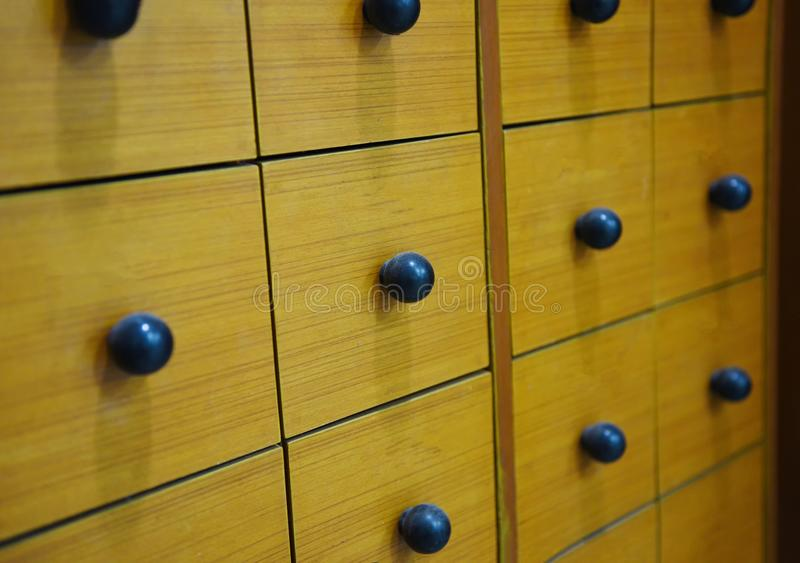 Wooden Drawer Apothecary - retro wood locker or file cabinet royalty free stock image