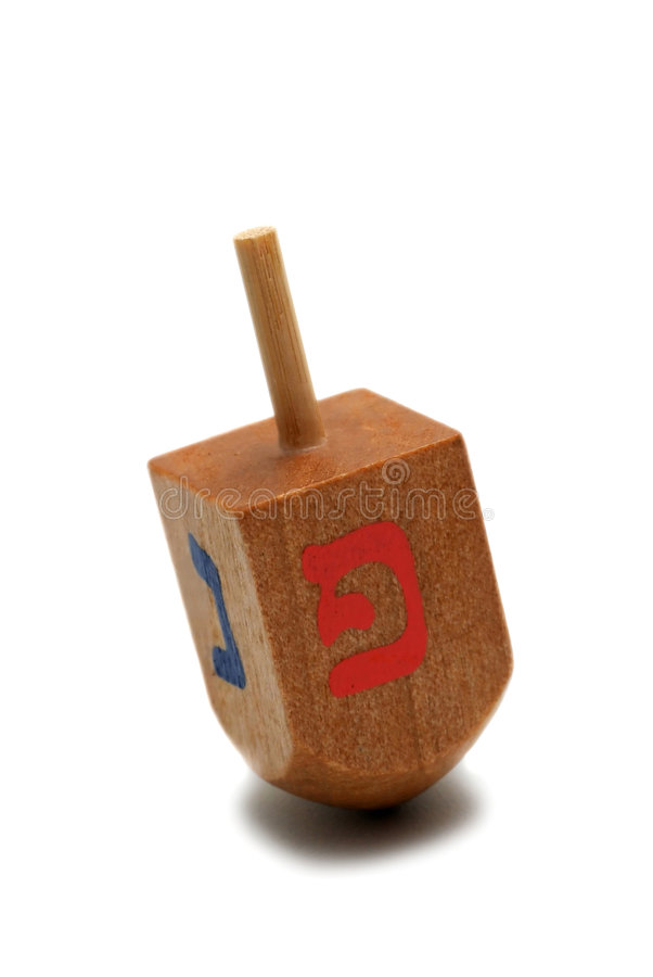 Wooden dreidel - hanukkah symbol. Isolated on white background stock image