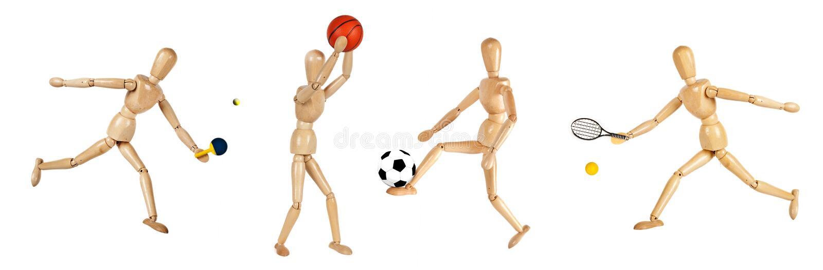 Wooden dummies playing sports stock image