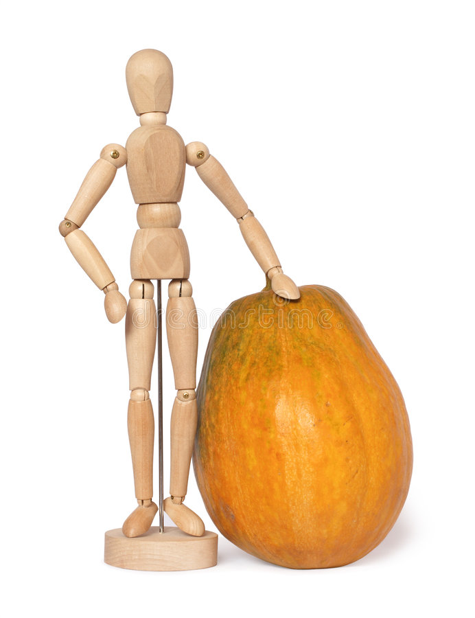 Wooden dummy with a big pumpkin royalty free stock image