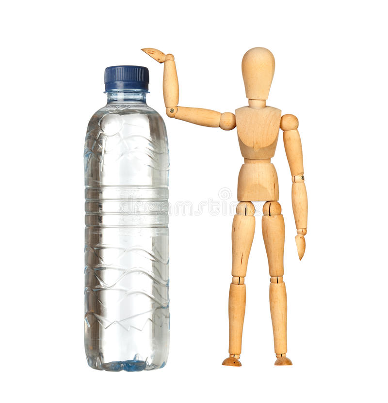Wooden dummy with a big water bottle stock photography