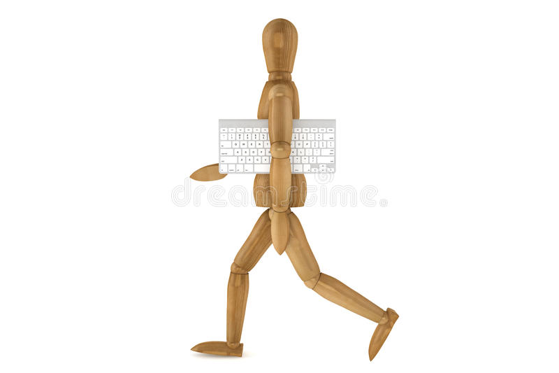 Wooden dummy with computer keyboard royalty free stock photography