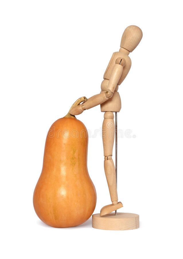 Wooden dummy and pumpkin royalty free stock photos
