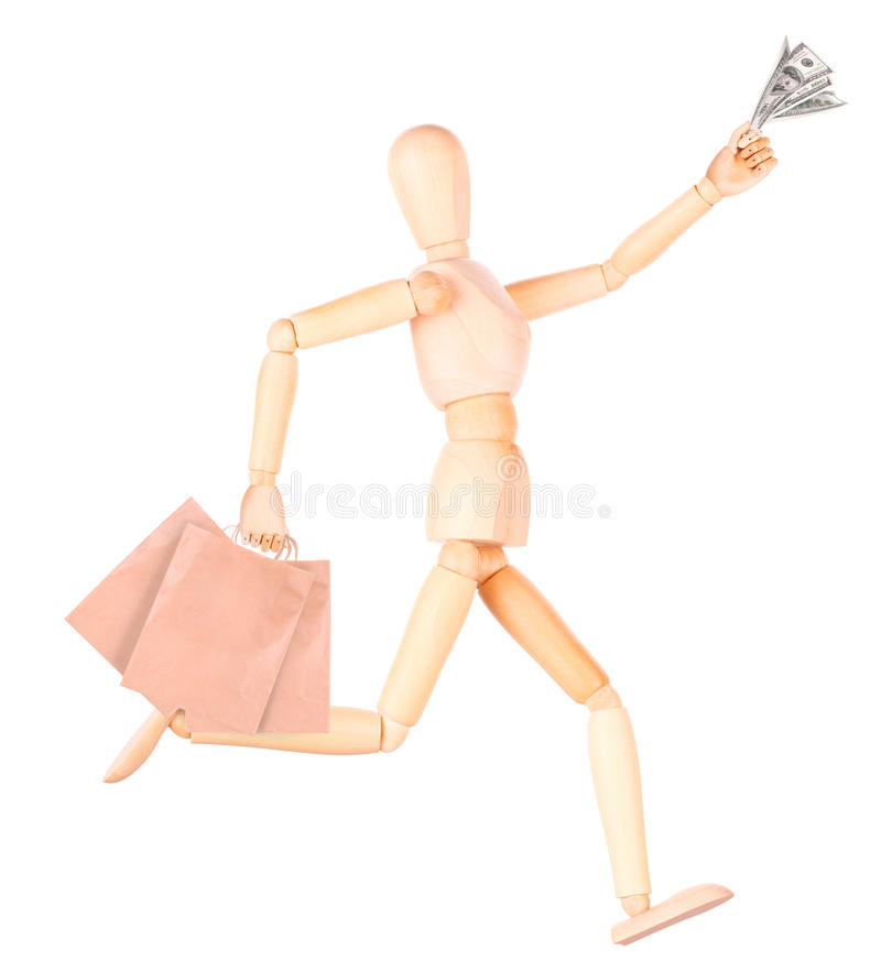Wooden Dummy with shopping bags and money royalty free stock photography