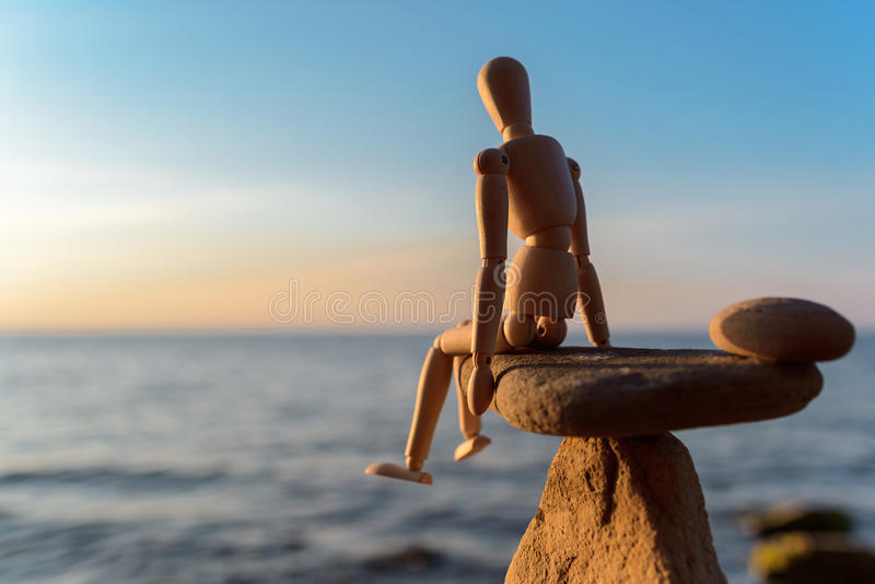 Wooden dummy on stone royalty free stock photography