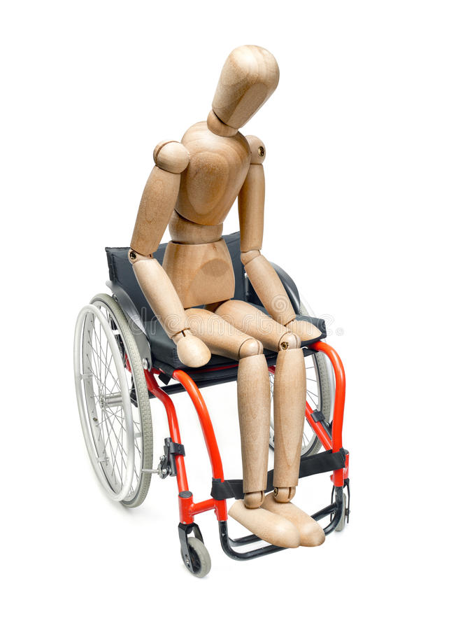 Wooden dummy on wheelchair. Wooden dummy sitting on wheelchair on white background stock image
