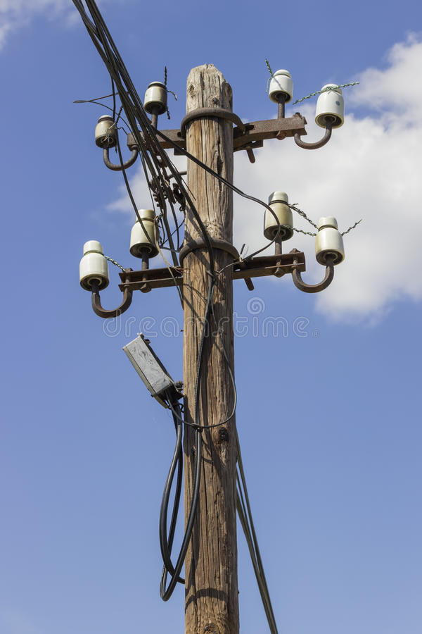 Wooden electrical pole with telephone lines. With sky background royalty free stock photos
