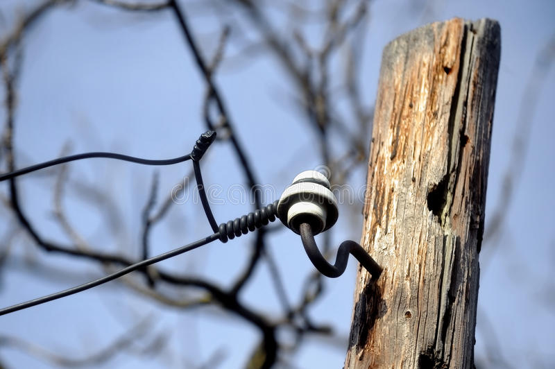 Wooden electricity pole. Industrial shot with old wooden electricity pole stock photo