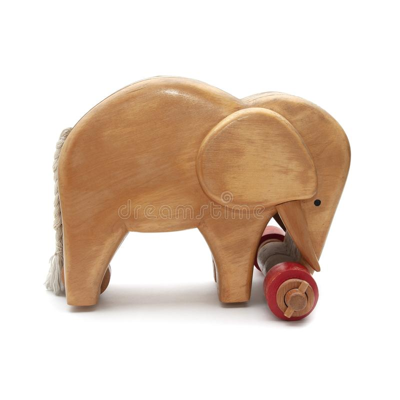 Wooden elephant with red wheels and tail from side royalty free stock photos