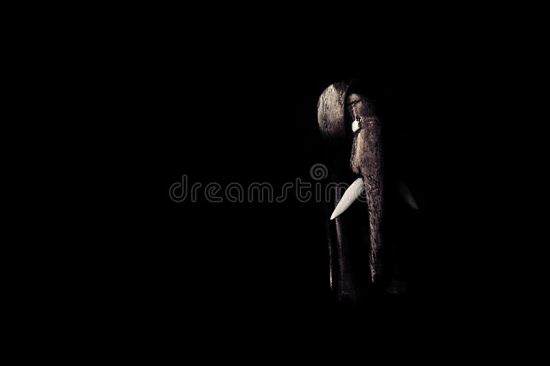 Wooden elephant statue with wood texture on black background royalty free stock image