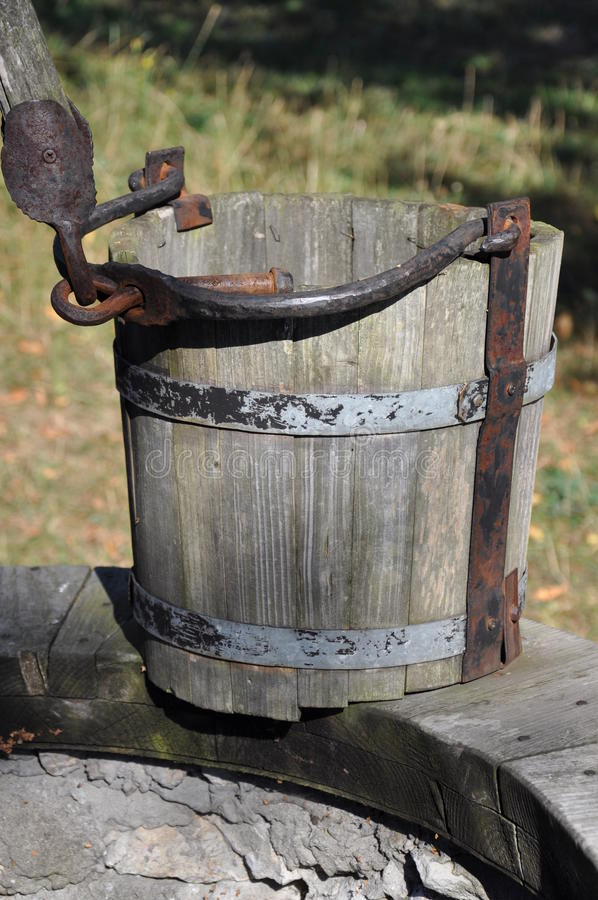 Wooden empty bucket at the well