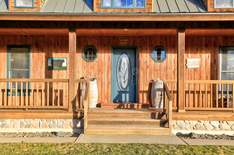 Wooden entrance porch with glass stained front door. Northwest, USA royalty free stock photography