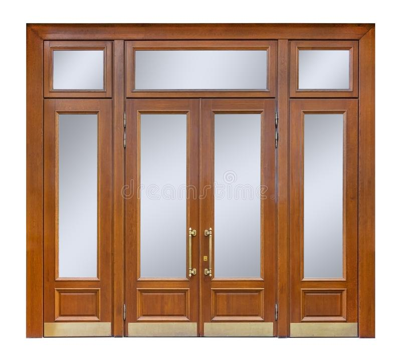 Wooden entry with clear glass windows and double door with long gilded handles, isolated on white background stock image