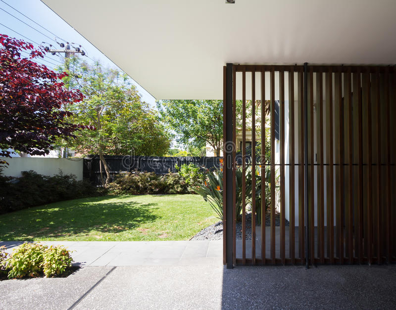 Wooden entry detail feature in contemporary Australian home. Wooden entry detail feature and front garden in contemporary Australian home royalty free stock images