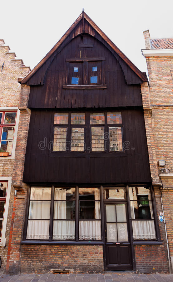 Wooden facade house Bruges / Brugge, Belgium. Wooden house in the medieval town of Bruges, Brugge, in Flanders, Belgium, with lamp and golden moon stock image