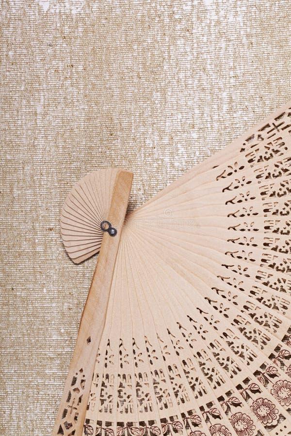 Wooden fan close-up geometric pattern. A Wooden fan close-up geometric pattern stock photography