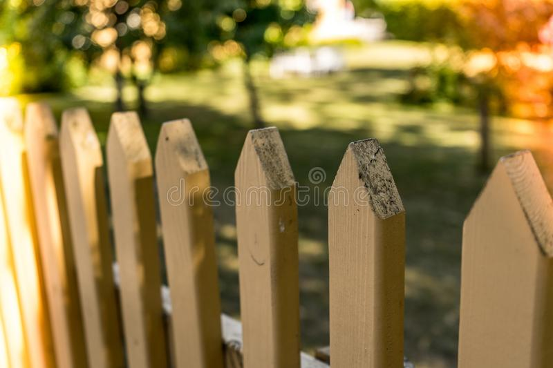 Wooden farm house fence with a trees in the background royalty free stock images