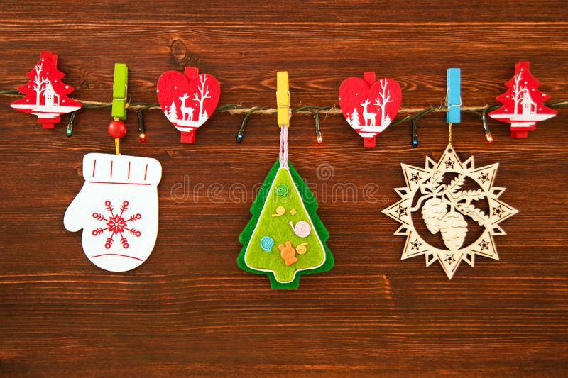 Wooden and felt christmas decorations and christmas lights on a rope download wooden and felt christmas decorations and christmas lights on a rope on the brown wooden aloadofball Gallery
