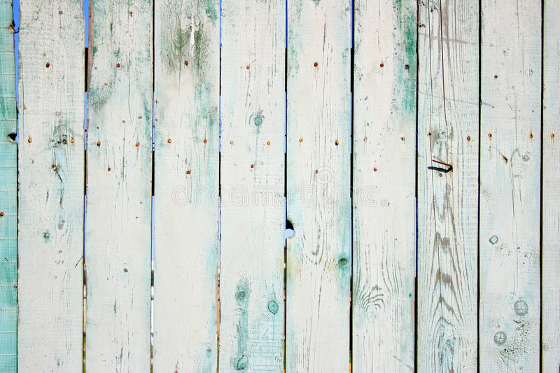 Wooden fence. Old painted wooden fence close-up, may be used as background stock photo