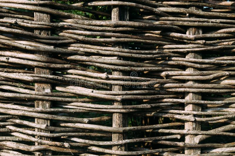 Wooden fence, assembled from flexible brown branches stock images