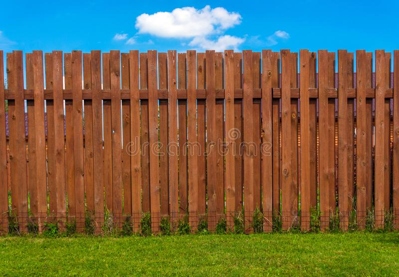 Wooden fence in a country house. Yard royalty free stock image