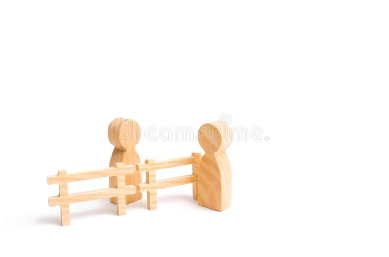 A wooden fence divides the two groups discussing the case. Termination and breakdown of relations, breaking ties. Contract break royalty free stock photos