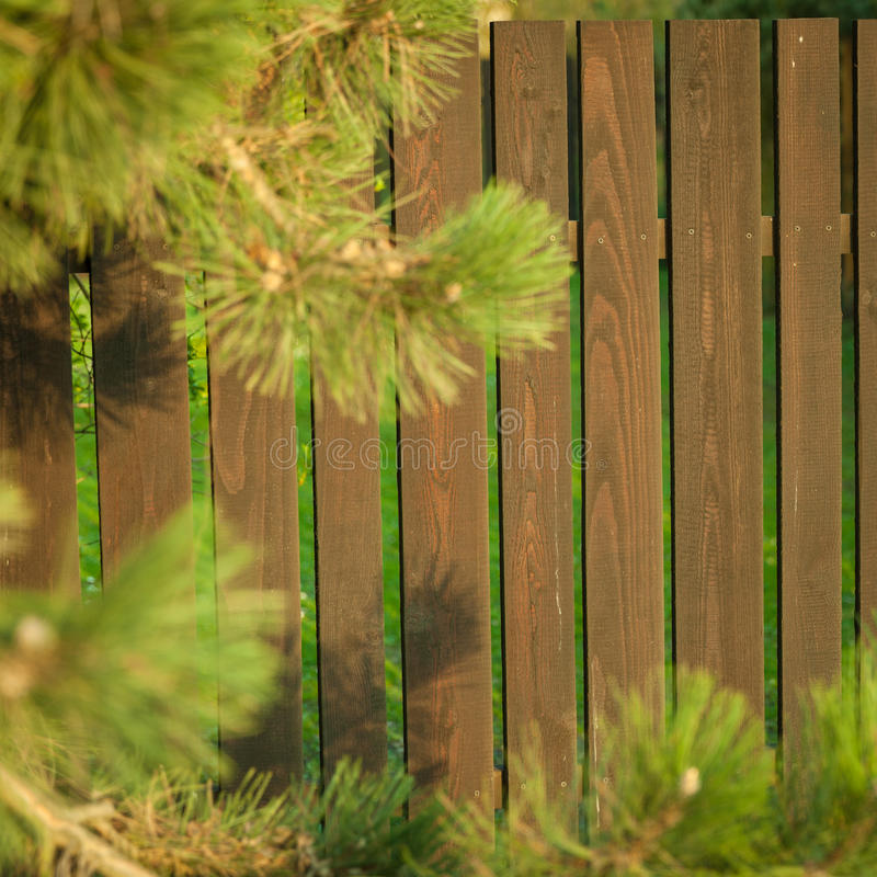 Wooden fence in the garden. Of a house stock image
