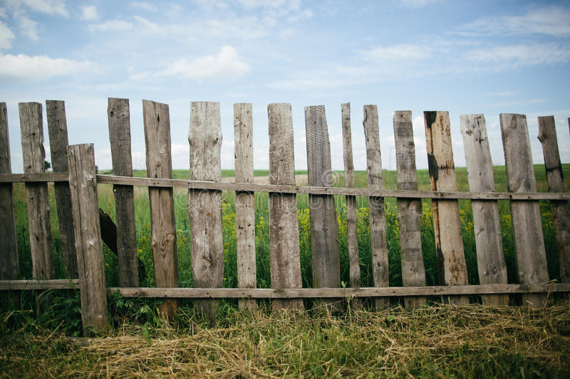 Wooden fence at the grass stock photography