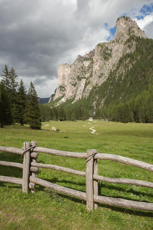 Wooden fence long a mountain pasture in Val Gardena stock images