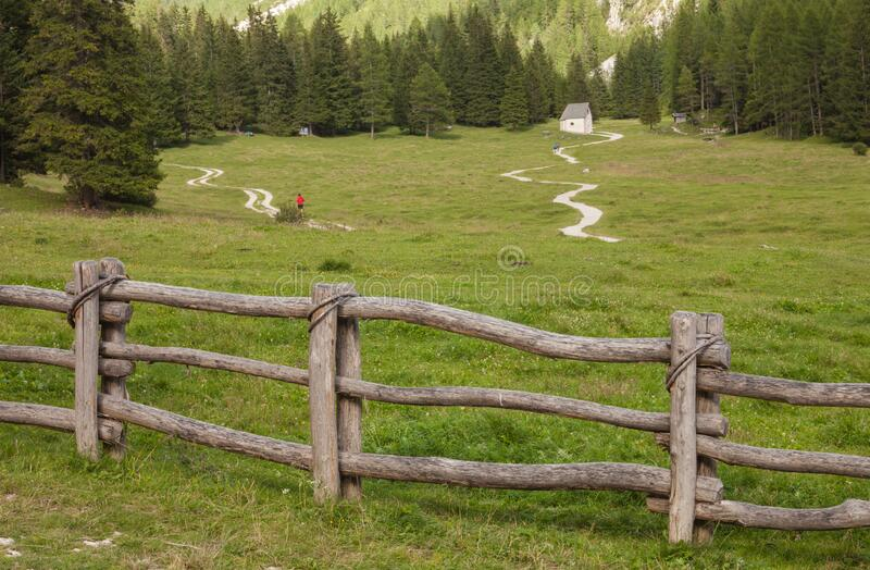 Wooden fence long a mountain pasture in Val Gardena royalty free stock image