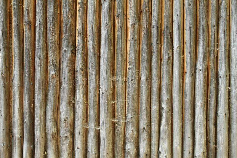 Wooden fence made of round woods stock photo