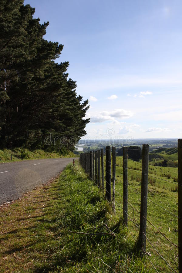 Wooden Fence next to country Road royalty free stock photography