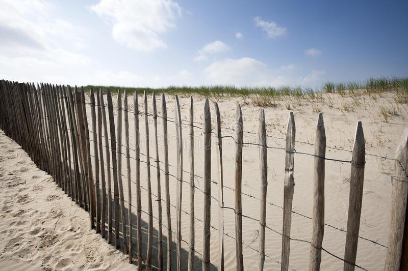 Wooden fence protecting the dunes royalty free stock images