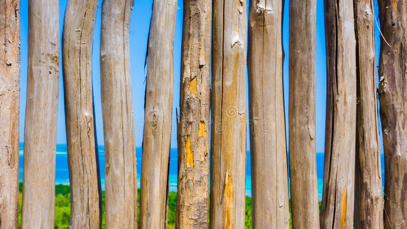 Wooden fence stick with beautiful aerial view of blue sea and green forest from bukit cinta or love mountain stock photography