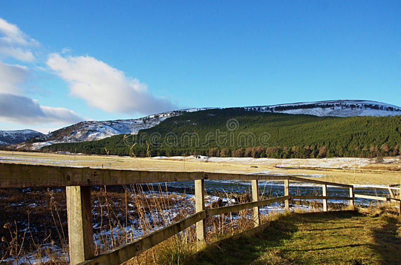 Wooden fence with view in background royalty free stock images