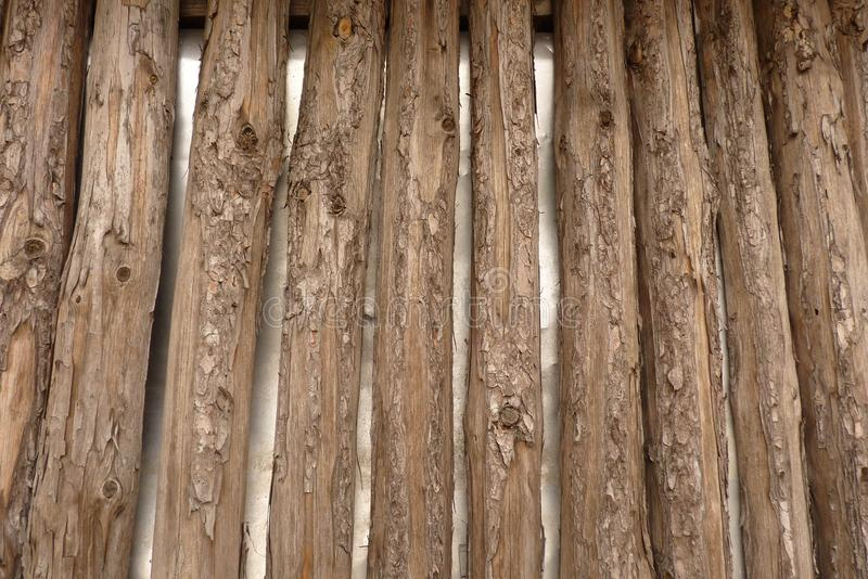 Wooden fence or wall of pine shapes. A rustic wooden fence or wall of pine shapes royalty free stock photography